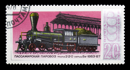 MOSCOW, RUSSIA - MARCH 31, 2018: A stamp printed in USSR (Russia) shows Passenger locomotive type 2-2-0, History of Russian Locomotives serie, circa 1978 Redakční