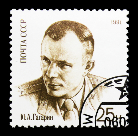 MOSCOW, RUSSIA - MARCH 31, 2018: A stamp printed in USSR (Russia) shows  Yury Gagarin in uniform, 30th Anniversary of First Man in Space serie, circa 1991 Редакционное