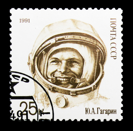 MOSCOW, RUSSIA - MARCH 31, 2018: A stamp printed in USSR (Russia) shows  Yury Gagarin wearing space suit, 30th Anniversary of First Man in Space serie, circa 1991