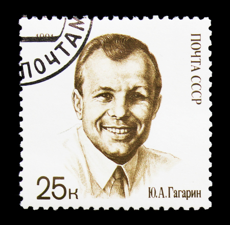 MOSCOW, RUSSIA - MARCH 31, 2018: A stamp printed in USSR (Russia) shows  Yury Gagarin in civilian dress, 30th Anniversary of First Man in Space serie, circa 1991