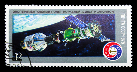 MOSCOW, RUSSIA - MARCH 31, 2018: A stamp printed in USSR (Russia) shows Soyuz and Apollo in Docking Procedure, Space Flight of Soyuz-19 and Apollo serie, circa 1975 Editorial