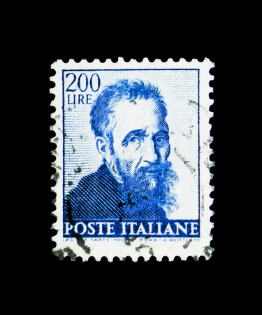 MOSCOW, RUSSIA - APRIL 15, 2018: A stamp printed in Italy shows Head of Michelangelo, Works of Michelangelo serie, circa 1961 Editöryel