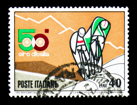 MOSCOW, RUSSIA - APRIL 15, 2018: A stamp printed in Italy shows Cyclists uphill, 50th anniversary of Italy cycling race serie, circa 1967