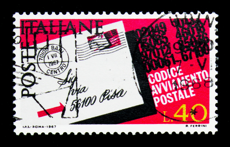MOSCOW, RUSSIA - APRIL 15, 2018: A stamp printed in Italy shows Postcard highlighted the postcode, Introduction of Postal Code serie, circa 1968 Editorial