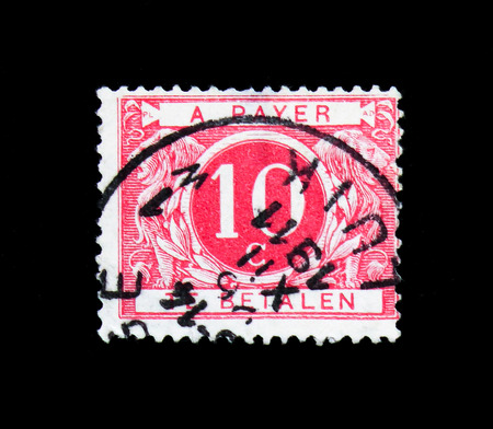 MOSCOW, RUSSIA - APRIL 15, 2018: A stamp printed in Belgium shows Cijfer, Postage Due - Coloured Circle serie, circa 1895