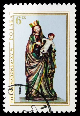 MOSCOW, RUSSIA - SEPTEMBER 15, 2018: A stamp printed in Poland shows The Beautiful Madonna, sculpture, 1410, Christmas serie, circa 1976