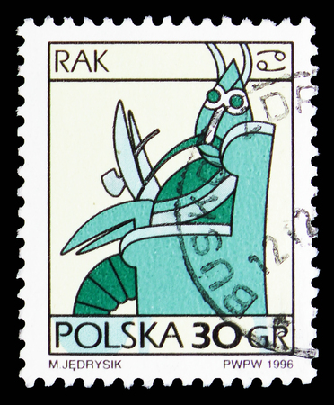 MOSCOW, RUSSIA - SEPTEMBER 15, 2018: A stamp printed in Poland shows Cancer, Zodiac signs serie, circa 1996 Редакционное