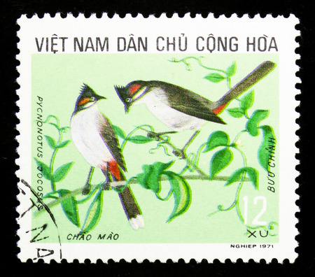 MOSCOW, RUSSIA - SEPTEMBER 26, 2018: A stamp printed in Vietnam shows Red-whiskered Bulbul (Pycnonotus jocosus), Birds Useful to Agricultureserie, circa 1973