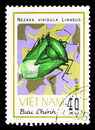 MOSCOW, RUSSIA - SEPTEMBER 26, 2018: A stamp printed in Vietnam shows Southern Green Stink Bug (Nezara viridula), Insects serie, circa 1982