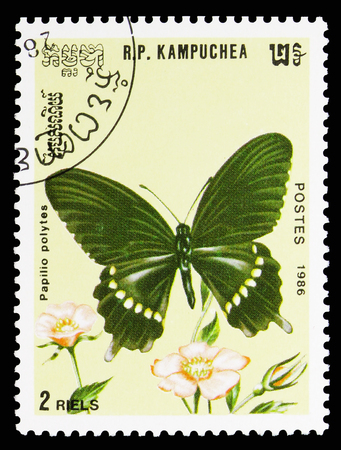 MOSCOW, RUSSIA - SEPTEMBER 26, 2018: A stamp printed in Kampuchea (Cambodia) shows Common Mormon (Papilio polytes), Butterflies serie, circa 1986