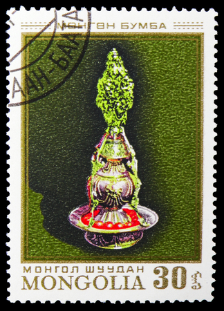 MOSCOW, RUSSIA - NOVEMBER 26, 2018: A stamp printed in Mongolia shows Candlestick, Costumes serie, circa 1974 Редакционное