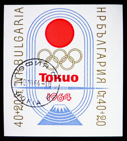 MOSCOW, RUSSIA - NOVEMBER 10, 2018: A stamp printed in Bulgaria shows Sun, Olympic Rings, Inscription and Fuji in Raceway, Olympic Games 1964 - Tokyo serie, circa 1964