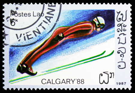 MOSCOW, RUSSIA - NOVEMBER 10, 2018: A stamp printed in Laos shows Ski jump, Olympics serie, circa 1987