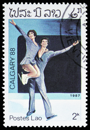 MOSCOW, RUSSIA - NOVEMBER 10, 2018: A stamp printed in Laos shows Figure Skating, Olympics serie, circa 1987