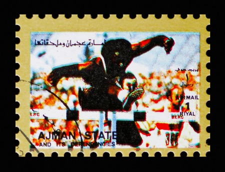 MOSCOW, RUSSIA - NOVEMBER 10, 2018: A stamp printed in Ajman shows Hurdle race, Summer Olympics serie, circa 1973