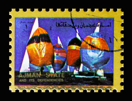 MOSCOW, RUSSIA - NOVEMBER 10, 2018: A stamp printed in Ajman shows Yachting, Summer Olympics serie, circa 1973