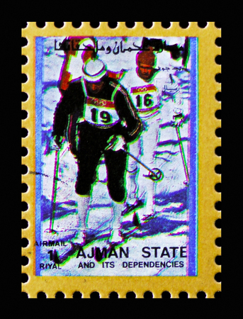 MOSCOW, RUSSIA - NOVEMBER 10, 2018: A stamp printed in Ajman shows Skiing, Winter Olympics serie, circa 1973