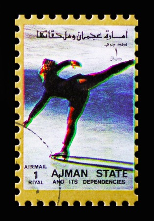 MOSCOW, RUSSIA - NOVEMBER 10, 2018: A stamp printed in Ajman shows Figure skating, Winter Olympics serie, circa 1973