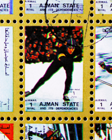 MOSCOW, RUSSIA - NOVEMBER 10, 2018: A stamp printed in Ajman shows Skating sport, Winter Olympics serie, circa 1973
