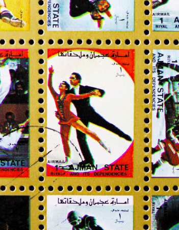 MOSCOW, RUSSIA - NOVEMBER 10, 2018: A stamp printed in Ajman shows Figure skating, Winter Olympics serie, circa 1973 Stock Photo - 117050917