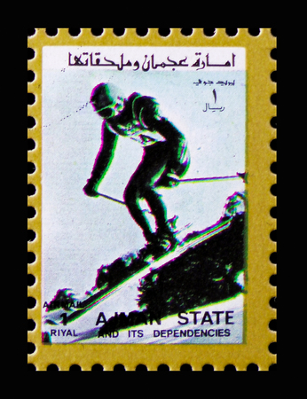 MOSCOW, RUSSIA - NOVEMBER 10, 2018: A stamp printed in Ajman shows Slalom, Winter Olympics serie, circa 1973 Editorial