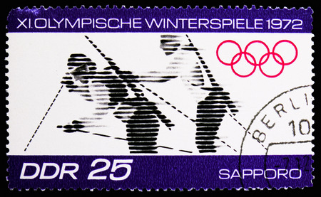 MOSCOW, RUSSIA - NOVEMBER 10, 2018: A stamp printed in Germany, Democratic Republic shows Biathlon, Winter Olympics 1972, Sapporo serie, circa 1971