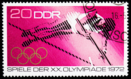 MOSCOW, RUSSIA - NOVEMBER 10, 2018: A stamp printed in Germany, Democratic Republic shows Pole vaulter, Summer Olympics 1972, Munich serie, circa 1972