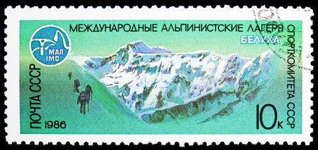 MOSCOW, RUSSIA - NOVEMBER 10, 2018: A stamp printed in USSR (Russia) shows Belukha Peak (4506 m.), Altaj, International Mountaineers Camps of USSR serie, circa 1986 Redakční