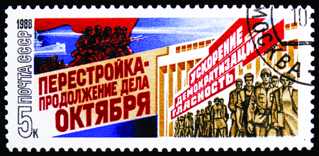 MOSCOW, RUSSIA - NOVEMBER 10, 2018: A stamp printed in USSR (Russia) shows Workers and soldiers and text, Perestroika serie, circa 1988