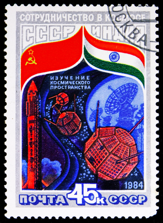 MOSCOW, RUSSIA - NOVEMBER 10, 2018: A stamp printed in USSR (Russia) shows Rocket Intercosmos, satellites and dish aerials, Soviet-Indian Space Flight serie, circa 1984