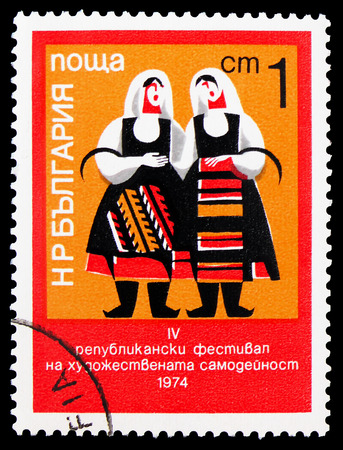MOSCOW, RUSSIA - FEBRUARY 9, 2019: A stamp printed in Bulgaria shows Regional costumes, Amateur Art festival and 4th National Sports Day serie, circa 1974