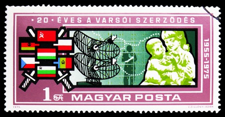 MOSCOW, RUSSIA - FEBRUARY 9, 2019: A stamp printed in Hungary shows Warsaw Pact, 20th anniversary, serie, circa 1975 Sajtókép