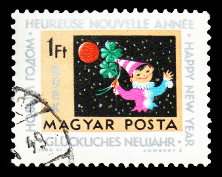 MOSCOW, RUSSIA - FEBRUARY 9, 2019: A stamp printed in Hungary shows Clown with balloon and clover, New Year serie, circa 1963