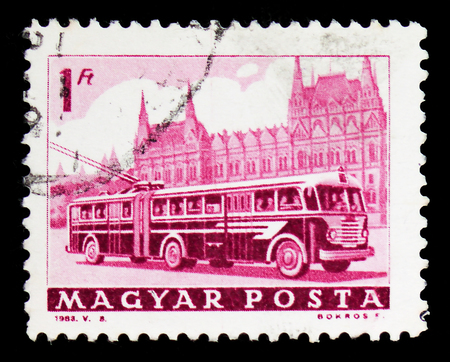 MOSCOW, RUSSIA - FEBRUARY 9, 2019: A stamp printed in Hungary shows Bus and Parliament, Transport and Telecommunication serie, circa 1963 Editorial