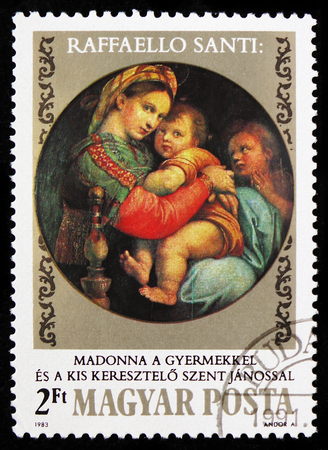 MOSCOW, RUSSIA - FEBRUARY 9, 2019: A stamp printed in Hungary shows Madonna and Child with Saint John, Paintings by Raffaello Santi serie, circa 1983