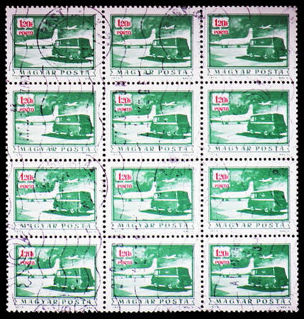 MOSCOW, RUSSIA - FEBRUARY 9, 2019: A stamp printed in Hungary shows Postage due - Mail plane and truck, serie, circa 1973 Editorial