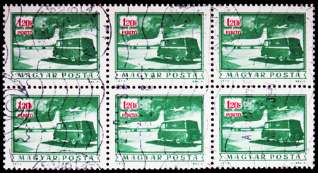 MOSCOW, RUSSIA - FEBRUARY 9, 2019: A stamp printed in Hungary shows Postage due - Mail plane and truck, serie, circa 1973 Editöryel