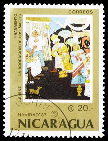 """MOSCOU, RUSSIE - 10 FÉVRIER 2019 : un timbre imprimé au Nicaragua montre """"Adoration des Mages"""", L. Saenz, série de Noël 1987, vers 1987 Éditoriale"""