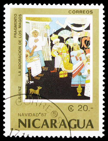 """MOSCOW, RUSSIA - FEBRUARY 10, 2019: A stamp printed in Nicaragua shows """"Adoration of the Magi"""", L. Saenz, Christmas 1987 serie, circa 1987 Editorial"""