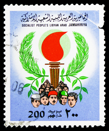 MOSCOW, RUSSIA - FEBRUARY 10, 2019: A stamp printed in Libyan Arab Jamahiriya shows People, Torch, Olive Branches, Burning Torch serie, circa 1979 Redakční