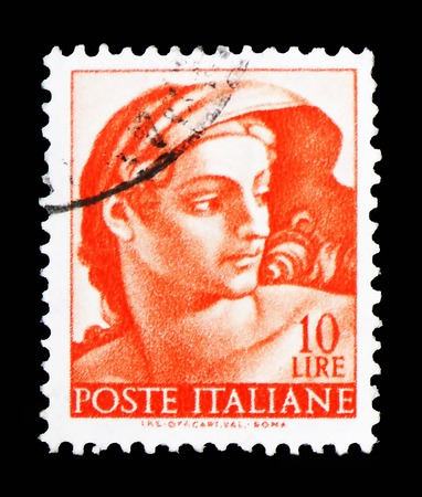 MOSCOW, RUSSIA - FEBRUARY 10, 2019: A stamp printed in Italy shows Head of naked, Works of Michelangelo serie, circa 1961