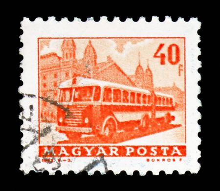 MOSCOW, RUSSIA - FEBRUARY 10, 2019: A stamp printed in Hungary shows Bus in front of Western Railway Station, Transport and Telecommunication serie, circa 1963