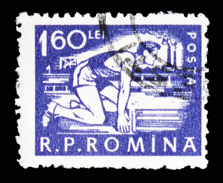 MOSCOW, RUSSIA - FEBRUARY 10, 2019: A stamp printed in Romania shows Runner at the start, Daily life serie, circa 1960