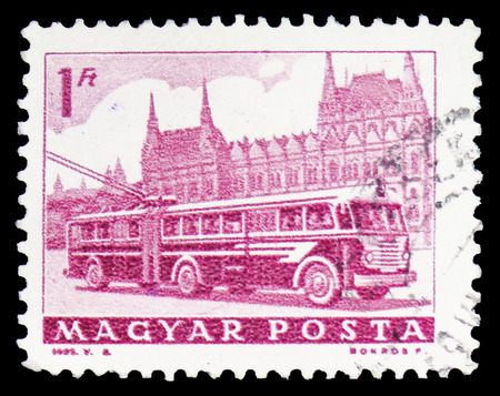 MOSCOW, RUSSIA - FEBRUARY 10, 2019: A stamp printed in Hungary shows Bus and Parliament, Transport and Telecommunication serie, circa 1963 Editorial