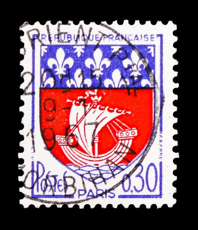 MOSCOW, RUSSIA - FEBRUARY 10, 2019: A stamp printed in France shows Paris, Coat of Arms serie, circa 1965 Редакционное
