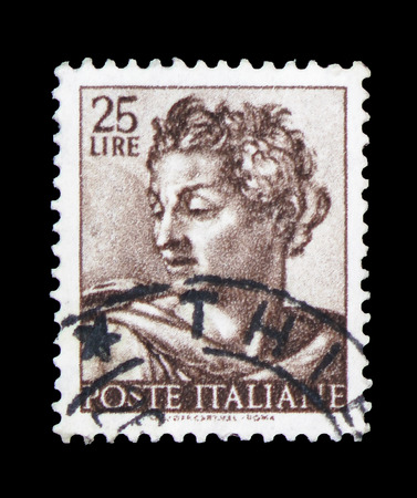 MOSCOW, RUSSIA - FEBRUARY 10, 2019: A stamp printed in Italy shows Head of the prophet Isaiah, Works of Michelangelo serie, circa 1961