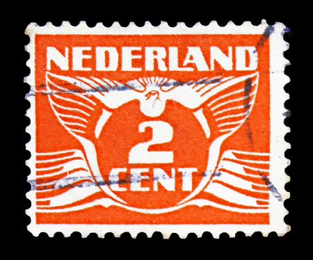 MOSCOW, RUSSIA - FEBRUARY 10, 2019: A stamp printed in Netherlands shows Flying dove, serie, circa 1926