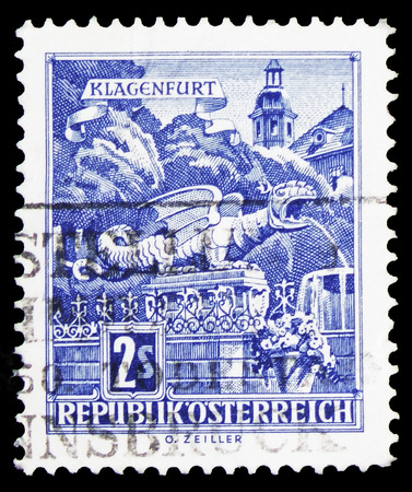 MOSCOW, RUSSIA - FEBRUARY 10, 2019: A stamp printed in Austria shows Wyvern Fountain at the New Place, Klagenfurt, Buildings serie, circa 1968 Redakční