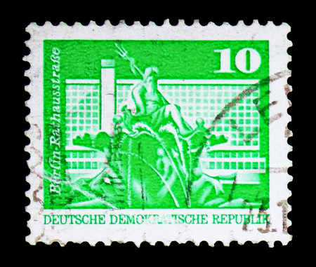 MOSCOW, RUSSIA - FEBRUARY 10, 2019: A stamp printed in Germany, Democratic Republic, shows Neptune Fountain and residential tower, Town Hall Street, Berlin, Construction in the GDR serie, circa 1973