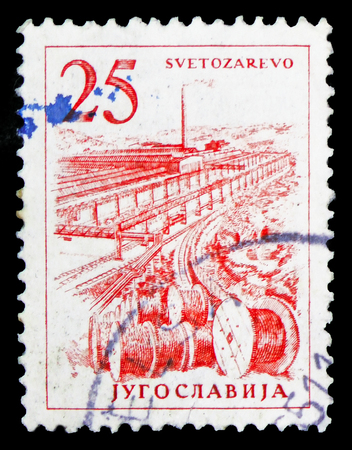 MOSCOW, RUSSIA - FEBRUARY 10, 2019: A stamp printed in Yugoslavia shows Cable factory in Svetozarevo, Engineering and Architecture serie, circa 1961